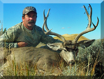 JOHN WITH ANOTHER BUCK HARVESTED WITH SWEETWATER OUTFITTERS.